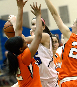 Ed Burke - The Saratogian 01/23/14 Saratoga's Julia O'Brien is pressured by Mohonasen's Saeeda Abdul-Aziz during Thursday's girls' varsity basketball matchup at Saratoga.