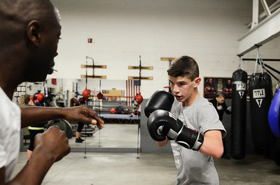 Erica Miller @togianphotog- The Saratogian,  At the Saratoga Boxing Club in Saratoga Springs on Weible Ave, at the Saratoga Ice Rink, Joey Barcia , only 14 years old from Schuylerville, worked out with coach Tyrone Jackson on Monday evening, Jan. 27, 2014. The three of them will be traveling to Kansas MI to compete in Nationals.