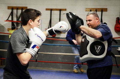 Erica Miller @togianphotog- The Saratogian,  At the Saratoga Boxing Club in Saratoga Springs on Weible Ave, at the Saratoga Ice Rink, Michael Barcia , only 12 years old from Schuylerville, worked out with coach Andy Faragon on Monday evening, Jan. 27, 2014. The three of them will be traveling to Kansas MI to compete in Nationals.