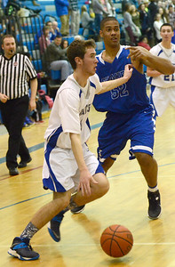 Ed Burke - The Saratogian 01/31/14 Saratoga's Liam Stewart dribbles past Shaker's Malik Dare during Friday's varsity basketball matchup at Saratoga.