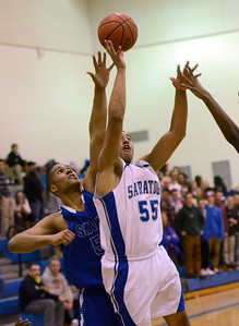 Ed Burke - The Saratogian 01/31/14 Saratoga's Jesse Alexander takes a shot under pressure from Shaker's Malik Dare during Friday's varsity basketball matchup at Saratoga.