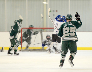 Ed Burke - The Saratogian 02/06/14; Shen's Cameron Kuhl signals one after teammate Kyle Marr's first period goal over Saratoga during Thursday's varsity hockey matchup at Saratoga Springs Ice Rink.