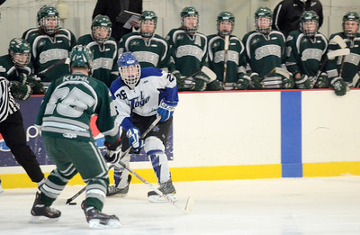 Ed Burke - The Saratogian 02/06/14; The Shen bench looks on as teammate Cameron Kuhl looks to challenege Saratoga's Elliott Hungerford during Thursday's varsity hockey matchup at Saratoga Springs Ice Rink.