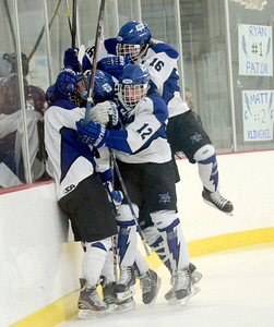 Ed Burke - The Saratogian 02/06/14; Saratoga Blue Streak teammates smother Jack Rittenhouse after his 1st period goal over Shen during Thursday's varsity hockey matchup at Saratoga Springs Ice Rink.