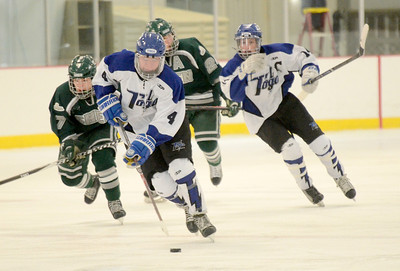 Ed Burke - The Saratogian 02/06/14; Saratoga's Jack Rittenhouse moves the puck against Shen during Thursday's varsity hockey matchup at Saratoga Springs Ice Rink.