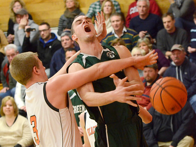 Ed Burke - The Saratogian 02/07/14; Greenwich's Justin Carruthers loses the ball after being fouled by Schuylerville's Nick Richard during Friday's matchup in Schuylerville.