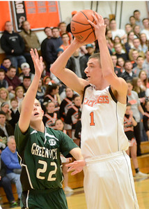 Ed Burke - The Saratogian 02/07/14; Schuylerville's Cameron Cook takes aim as Greenwich defender John Stewart tries to block during Friday's matchup in Schuylerville.