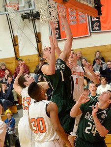 Ed Burke - The Saratogian 02/07/14; Greenwich's Justin Carruthers finds room to the basket during Friday's matchup in Schuylerville.