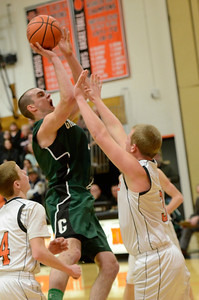 Ed Burke - The Saratogian 02/07/14; Greenwich's Justin Carruthers shoots over Schuylerville defender Nick Richard during Friday's matchup in Schuylerville.