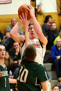 Ed Burke - The Saratogian 02/07/14; Schuylerville's Will Griffen takes aim as Greenwich defender Kelvin Williamson guards during Friday's matchup in Schuylerville.