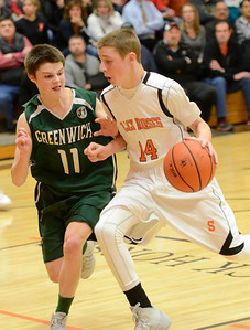 Ed Burke - The Saratogian 02/07/14; Greenwich's Sean Estramonte shadows Schuylerville's Zack Pierce during Friday's matchup in Schuylerville.