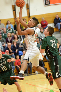 Ed Burke - The Saratogian 02/07/14; Schuylerville's Dante Langley goes to the basket during Friday's matchup against Greenwich in Schuylerville.