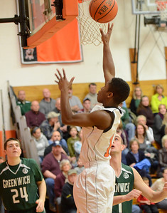Ed Burke - The Saratogian 02/07/14; Schuylerville's Naquan Mclennon goes to the basket during Friday's matchup aginst Greenwich in Schuylerville.