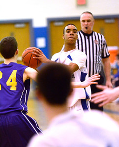 Ed Burke - The Saratogian 02/11/14 Saratoga's Cam Ellis looks to pass as Ballston's Sean Walsh guards during Tuesday's game at Saratoga.