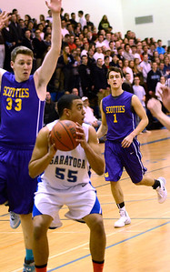 Ed Burke - The Saratogian 02/11/14 Saratoga's Jesse Alexander waits to shoot as Ballston's Josiah Dillon lurks above during Tuesday's game at Saratoga.