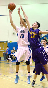 Ed Burke - The Saratogian 02/11/14 Saratoga's Noah Arciero shoots from outside under pressure from Ballston's Cliff Stevens during Tuesday's game at Saratoga.