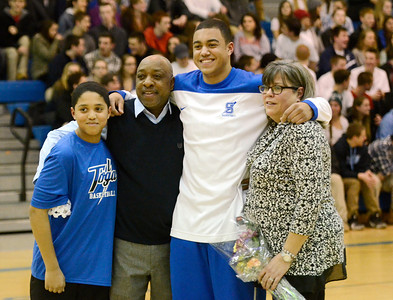 Ed Burke - The Saratogian 02/11/14 Saratoga's Jesse Alexander stands with parents Laurie and Jesse and brother Parker during Senior Night at Tuesday's game versus Ballston Spa at Saratoga.