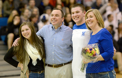 Ed Burke - The Saratogian 02/11/14 Saratoga's Nick Stiansen stands with parents Pam and Steve and sister Jenna during Senior Night at Tuesday's game versus Ballston Spa at Saratoga.