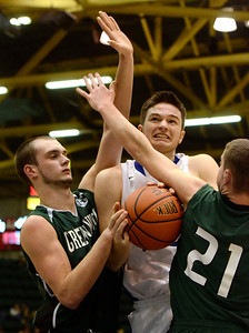 Ed Burke - The Saratogian 02/26/14 Hoosic's John Rooney is pressured by Greenwich defenders Justin Carruthers, left, and Lukas Whitehouse during Wednesday's Class C semi-final in Glens Falls.