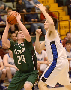 Ed Burke - The Saratogian 02/26/14 Greenwich's George Ostrowski is guarded by Hoosic Valley's John Rooney during Wednesday's Class C semi-final in Glens Falls.