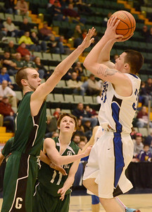 Ed Burke - The Saratogian 02/26/14 Greenwich's Justin Carruthers tries to block a shot by Hoosic Valley's Mike Pierre during Wednesday's Class C semi-final in Glens Falls.