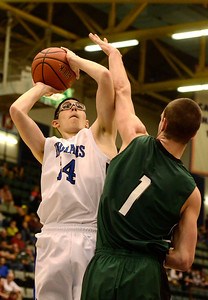 Ed Burke - The Saratogian 02/26/14 Hoosic's Cole Carner shoots over Greenwich defender Justin Carruthers during Wednesday's Class C semi-final in Glens Falls.