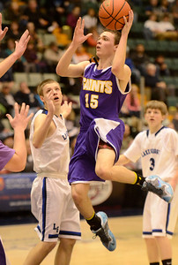 Ed Burke - The Saratogian 02/26/14 Saratoga Central Catholic's Brian Hall tries for two against Lake George during Wednesday's Class C semi-final at the Glens Falls Civic Center.