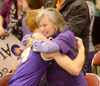 Ed Burke - The Saratogian 02/26/14 Saratoga Central Catholic's JRHmura shares a victory hug with Saints' superfan Elly Beson, wife Spa Catholic golf coach and supporter Mike Beson who passed away in October during Wednesday's Class C semi-final win over Lake George in Glens Falls.