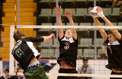 Ed Burke - The Saratogian Burnt Hills-Ballston Lake volleyball players Cody Pearce (3) and Riley Hynes try and block a spike by Kennedy High School's Justin Feigeles during Friday's state volleyball championships at the Glens Falls Civic Center.