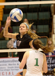 Ed Burke - The Saratogian Burnt Hills-Ballston Lake volleyball player Kathleen Shurman hits past Cornwall defender Pat Harnett during Saturday's state volleyball championships at the Glens Falls Civic Center.