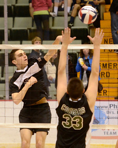 Ed Burke - The Saratogian Burnt Hills-Ballston Lake volleyball player Sam Pelton hits into defense by Kennedy High School's Zach Goldhirsch during Friday's state volleyball championships at the Glens Falls Civic Center.