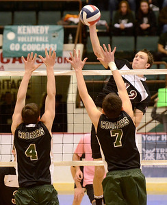 Ed Burke - The Saratogian Burnt Hills-Ballston Lake volleyball player Austin Nydegger hits into defense by Kennedy High School's Zach Evan Golodner (4) and Andrew Sheehan during Friday's state volleyball championships at the Glens Falls Civic Center.