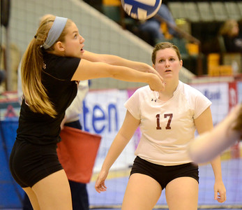 Ed Burke - The Saratogian Burnt Hills-Ballston Lake volleyball player Kathleen Shurman sets the ball as Lindsay Bynon looks on during Saturday's state volleyball championships at the Glens Falls Civic Center.