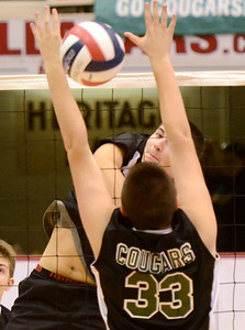 Ed Burke - The Saratogian Burnt Hills-Ballston Lake volleyball player Riley Hines hits into defense by Kennedy High School's Zach Goldhirsch during state volleyball championships at the Glens Falls Civic Center.
