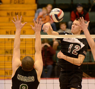 Ed Burke - The Saratogian Burnt Hills-Ballston Lake volleyball player Austin Nydegger spikes the ball as Kennedy High School's Justin Ganca jumps to defend during Friday's state volleyball championships at the Glens Falls Civic Center.