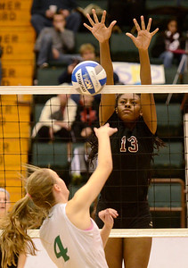 Ed Burke - The Saratogian Burnt Hills-Ballston Lake volleyball player Jaleah Owens blocks a shot by Cornwall's Kaitlin Murphy during Saturday's state volleyball championships at the Glens Falls Civic Center.
