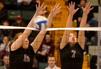 Ed Burke - The Saratogian Burnt Hills-Ballston Lake volleyball playes Kelly Waters (18) and Natalie Shurman block a Cornwall attempt during Saturday's state volleyball championships at the Glens Falls Civic Center.
