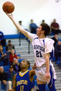 Ed Burke - The Saratogian 12/03/13 Saratoga's Sean Gecco  goes to the basket over Queensbury's Kalen Minott during Tuesday's game at Saratoga.