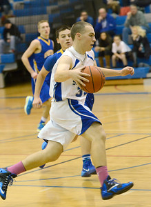 Ed Burke - The Saratogian 12/03/13 Saratoga's Zach Kircher drives the ball during Tuesday's game against Queensbury at Saratoga.
