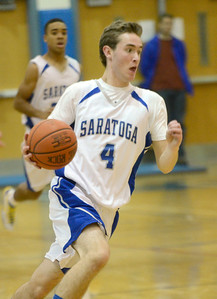 Ed Burke - The Saratogian 12/03/13 Saratoga's Liam Stewart moves the ball during Tuesday's game against Queensbury at Saratoga.