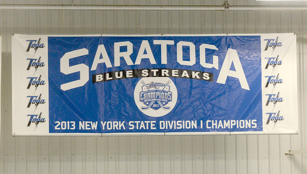 Ed Burke - The Saratogian 12/06/13 The Saratoga Springs Blue Streak varsity hockey team competed under a new banner unveiled Friday recognizing last year's state championship team. Saratoga was matched up against Mamaroneck in the first day of the Don Kauth Memorial Tournament.