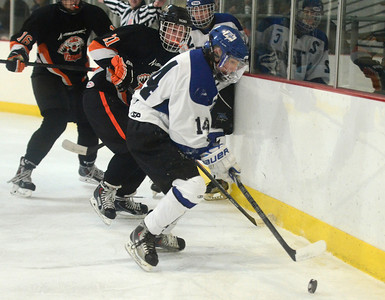 Ed Burke - The Saratogian 12/06/13 Saratoga's Drew Patterson works the puck behind the net as Mamaroneck defenders close in during Friday's opening round of the Don Kauth Memorial Tournament.
