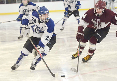 Ed Burke - The Saratogian 12/07/13 Saratoga's Jake Fauler looks for options as St. Joseph's Brad Kaminski tries to block during Saturday's action in the Don Kauth Memorial Tournament at Saratoga Springs Ice Rink.