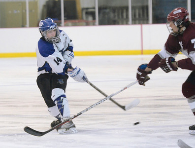 Ed Burke - The Saratogian 12/07/13 Saratoga's Drew Paterson shoots on goal as St. Joseph's Matt Ruggierio tries to block during Saturday's action in the Don Kauth Memorial Tournament at Saratoga Springs Ice Rink.