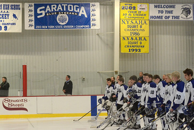 Ed Burke - The Saratogian 12/06/13 The Saratoga Springs Blue Streak varsity hockey team lines up for the National Anthem under a new banner, left, unveiled Friday recognizing last year's state championship team. Saratoga was matched up against Mamaroneck in the first day of the Don Kauth Memorial Tournament.