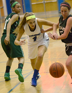 Ed Burke - The Saratogian 12/13/13 Saratoga's Amanda Flemming battles with Shen's Erin Hulbert for a loose ball as Sydney Brown looks on during Friday's game at Saratoga.
