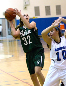 Ed Burke - The Saratogian 12/13/13 Shen's Carly Boland goes up behind Saratoga defender Ann Mahoney during Friday's game at Saratoga.