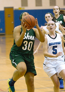 Ed Burke - The Saratogian 12/13/13 Shen's Samira Sangare goes up for a shot as Saratoga's Lindsay Rutz looks on during Friday's game at Saratoga.