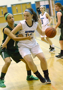 Ed Burke - The Saratogian 12/13/13 Saratoga's Madison Stanley is pressured by Shen's Sydney Brown during Friday's game at Saratoga.