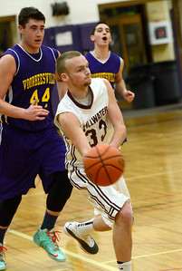Ed Burke - The Saratogian 12/27/13 Stillwater's Schuyler Radliff paases the ball pursued by Voorheesville's Joe Vogel during Friday's action in Saratoga Central Catholic's Christmas basketball tournament.
